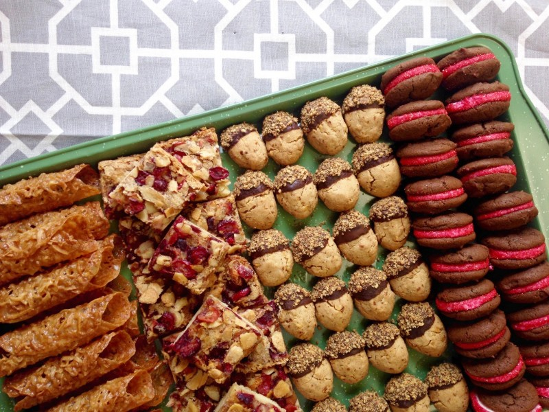 four types of fancy cookies on a tray