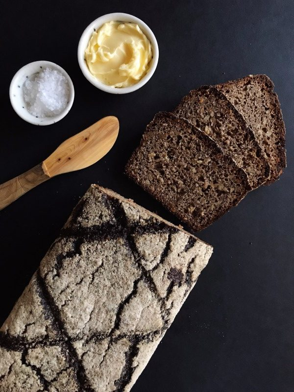 Vollkornbrot loaf with spreading knife, butter, and salt