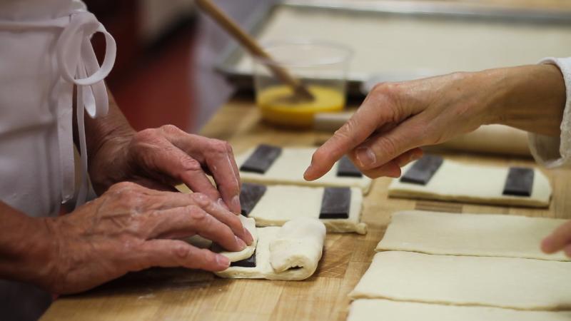 hands making croissants