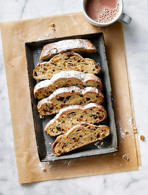 Stollen bread cut into slices on a baking sheet