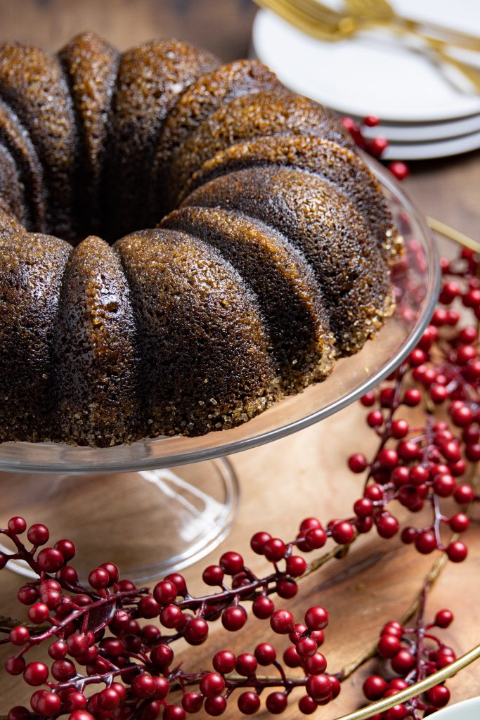 a gingerbread coffee cake on a cake stand