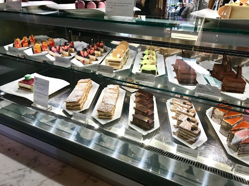 a pastry case filled with slices of different Hungarian cakes