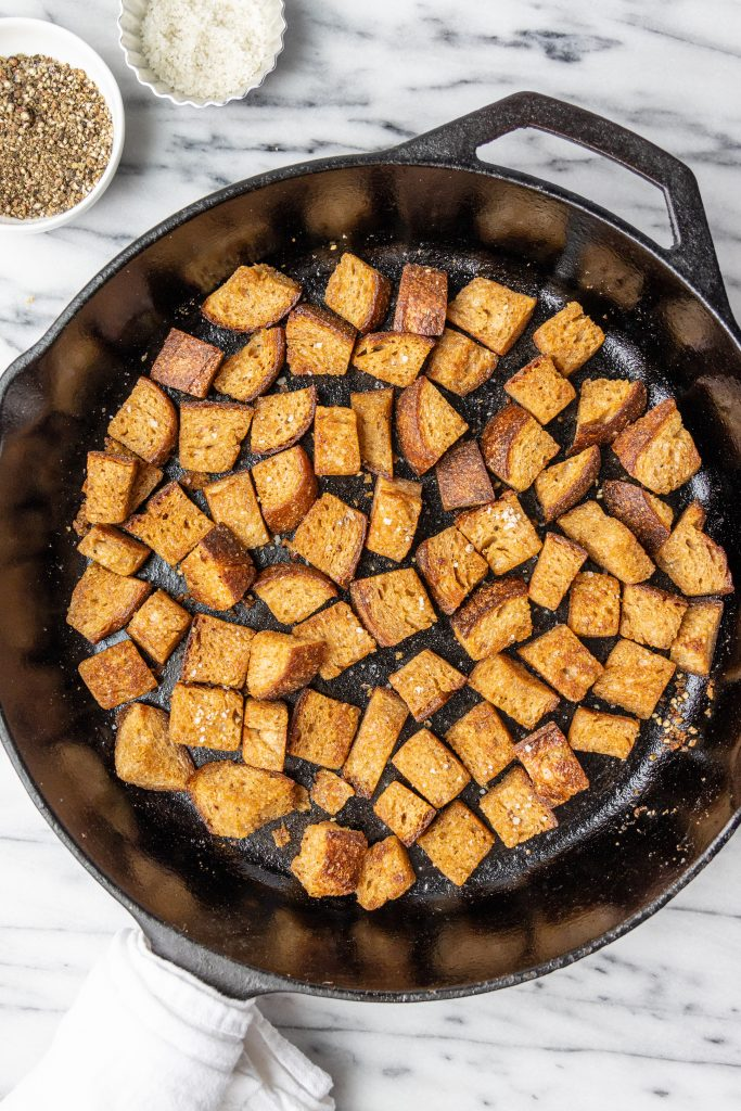 croutons in a cast-iron pan