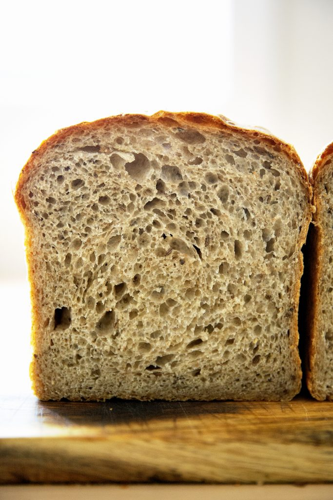 halved loaf of rye bread